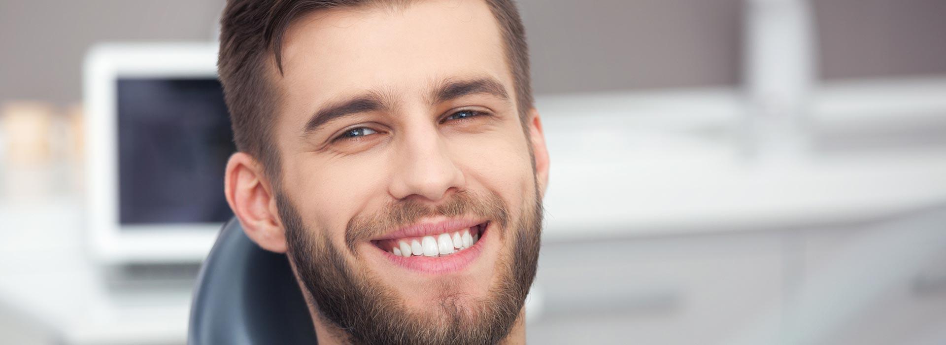 Happy man after having dental bonding treatment