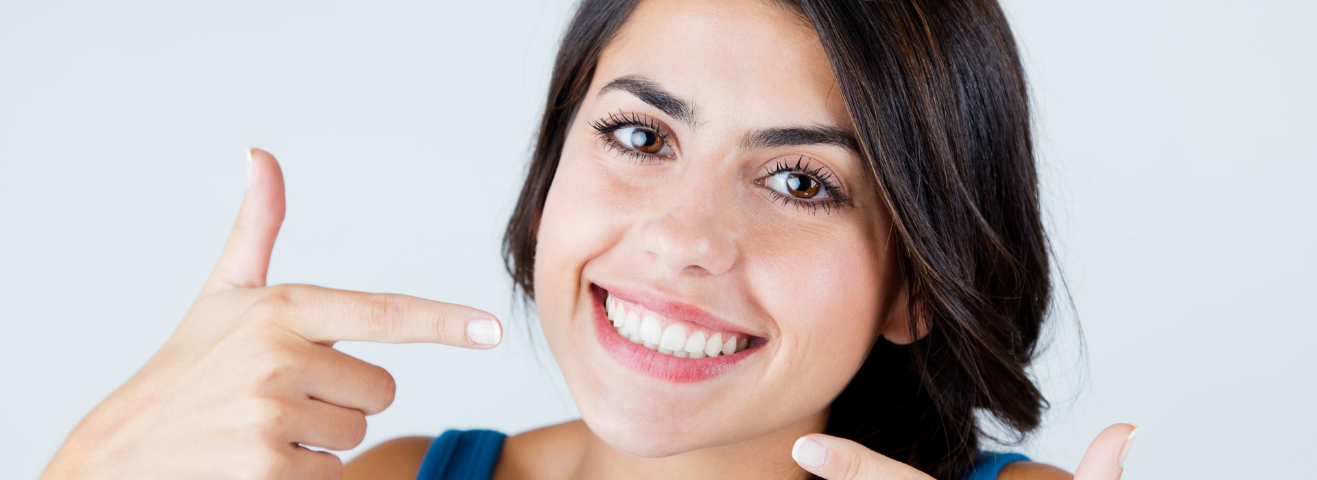 Happy woman after having fluoride treatments