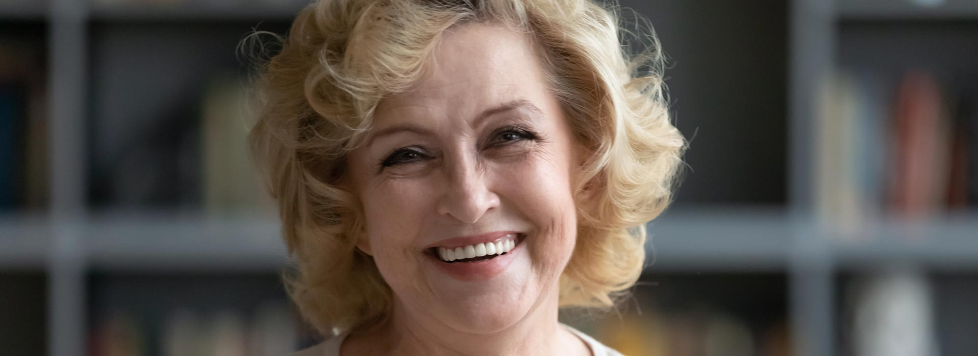 Happy woman after having dental implant treatment