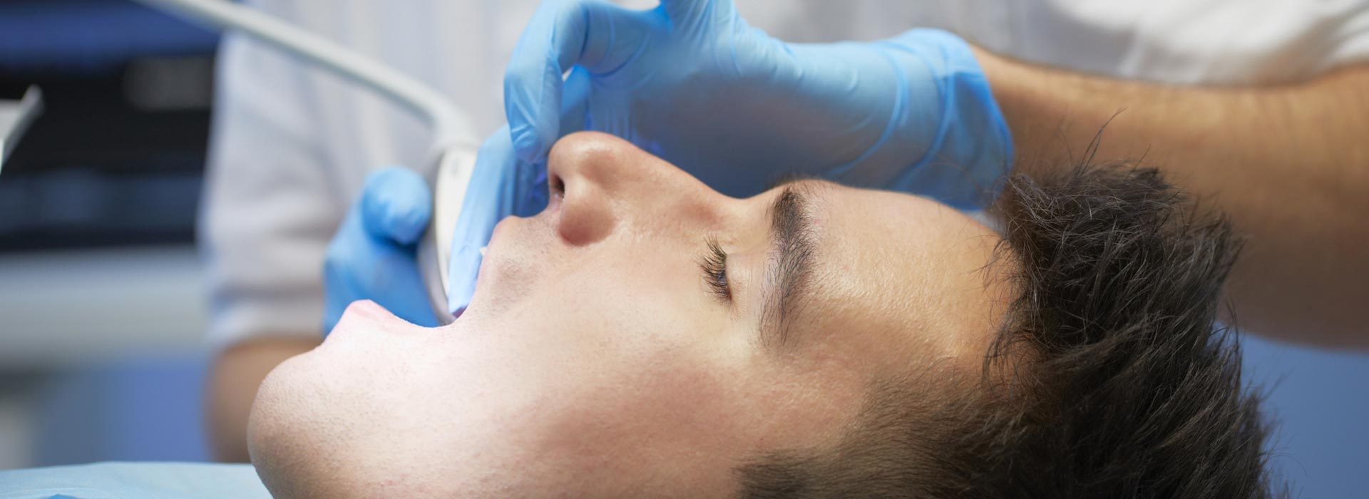 A dentist doing oral surgery